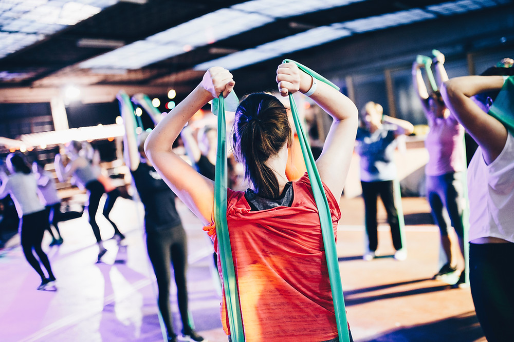 woman in a group exercise class working out