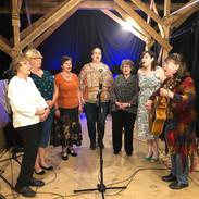 Women of Honeybee performing in Thomas,