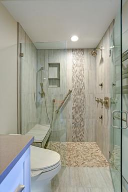 Contemporary bathroom design with custom accent tile