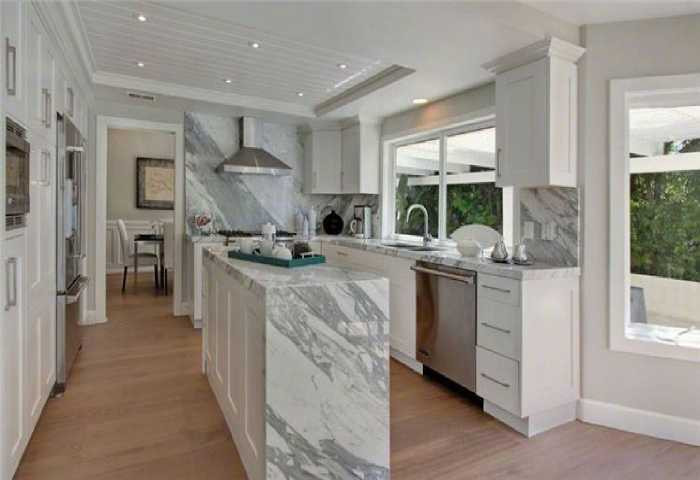 marble kitchen design on walls and counters
