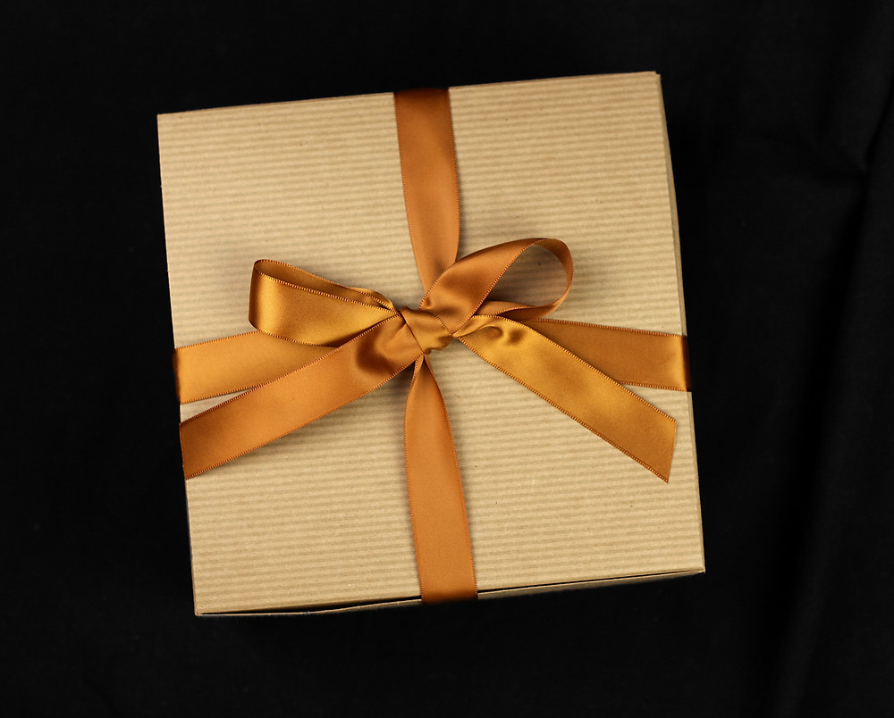 Delicately tied cotton satin ribbon on gift box. Simple but elegant gift wrapping.