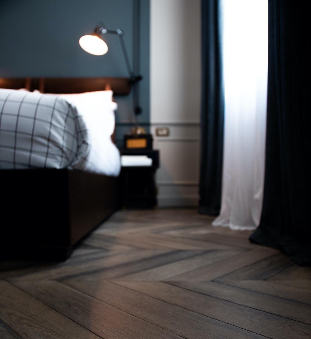 Moody Dark Turquoise Blue Bedroom with Herringbone Wood Floor