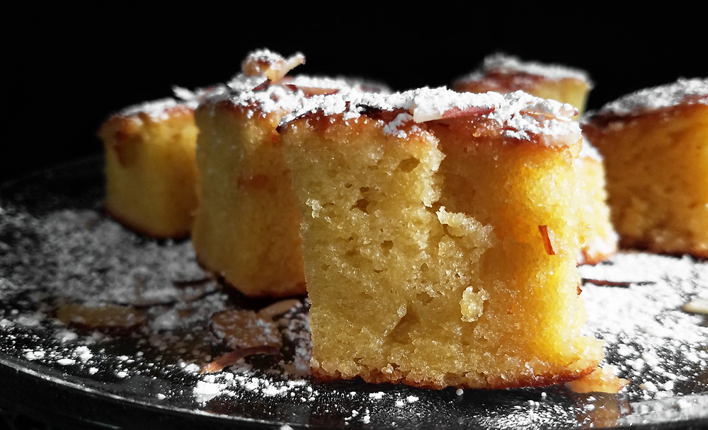 A spongey, moist Olive Oil Cake with orange and almond flavoring. Versatile with lots of flavor.