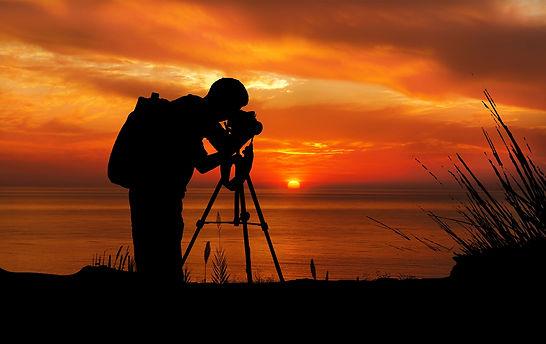MorePhotos-photographer-at-sunset-silhou