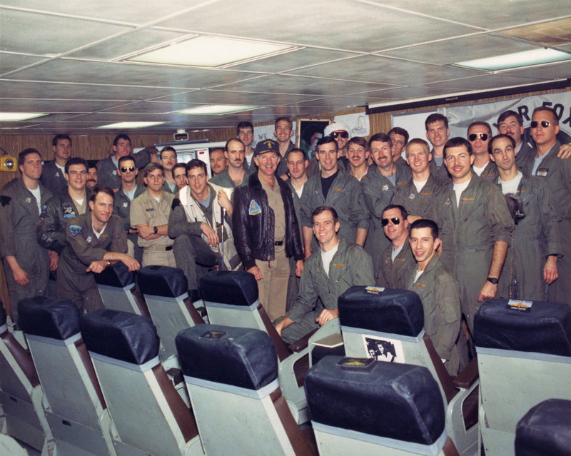 "CAG-2 ""Rabbit"" Campbell visits the VA-155 ready room on board USS Ranger (CV 61).  Note that Elvis had not left the building!"