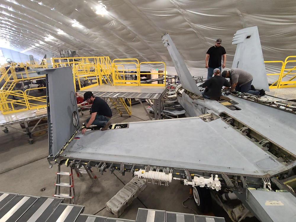 The NAMCE hangar is a hotbed of activity as its professional maintainers diligently restore long-term down aircraft for return to squadrons after years of not flying.