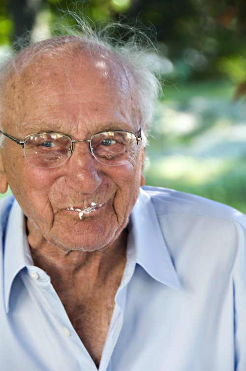 My Grandfather Michael eating cake on his 100th birthday.  Photo by Bello Photo