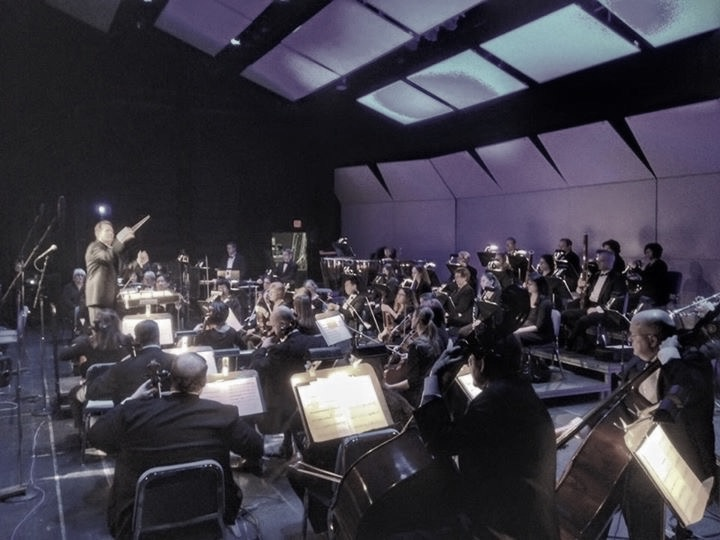 With symphony orchestra