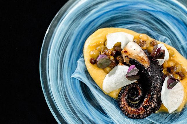 Roasted octopus, wild beans purea