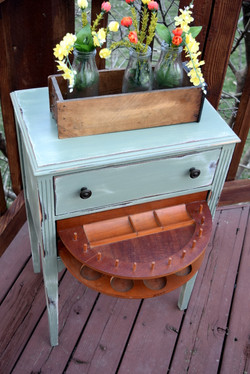 antique sewing cabinet in basil