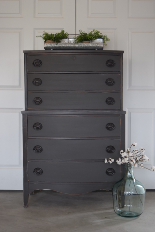 antique dresser in gravel road