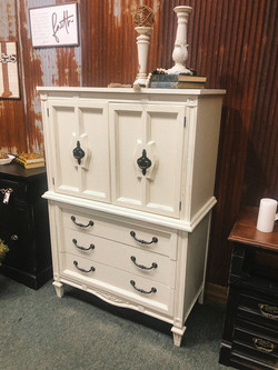 distressed armoire in drop cloth