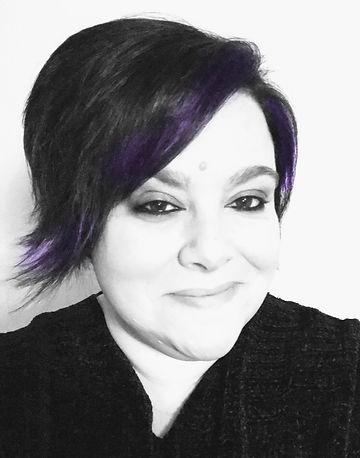 LIZ_JOHNSON_HEADSHOT_purple_edited.jpg