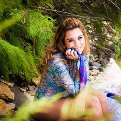 woman posing in shrubs 3