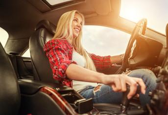 Young Woman Drives A Car.jpg