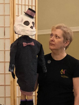 Death puppet and puppeteer Lynne