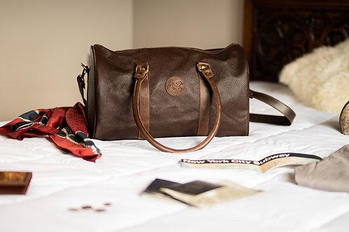 Small Brown leather travel bag. BOLS 23