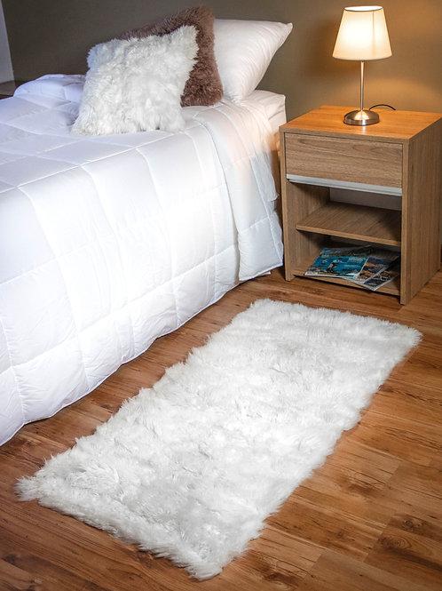 White Sheepskin bedside carpet  (long). BAJ 05