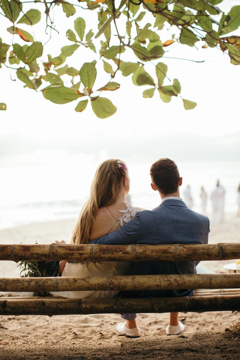 "alt=""couple sitting on bamboo swing"""