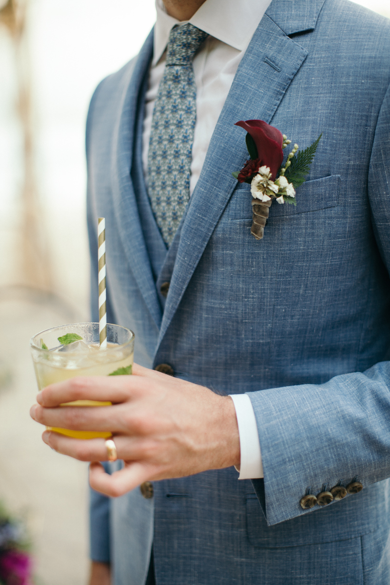 """alt=""""groom's boutonniere and drink"""""""