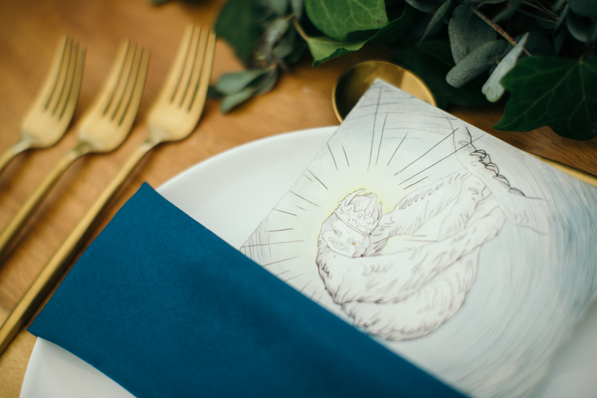 "alt=""sloth drawing at place setting"""