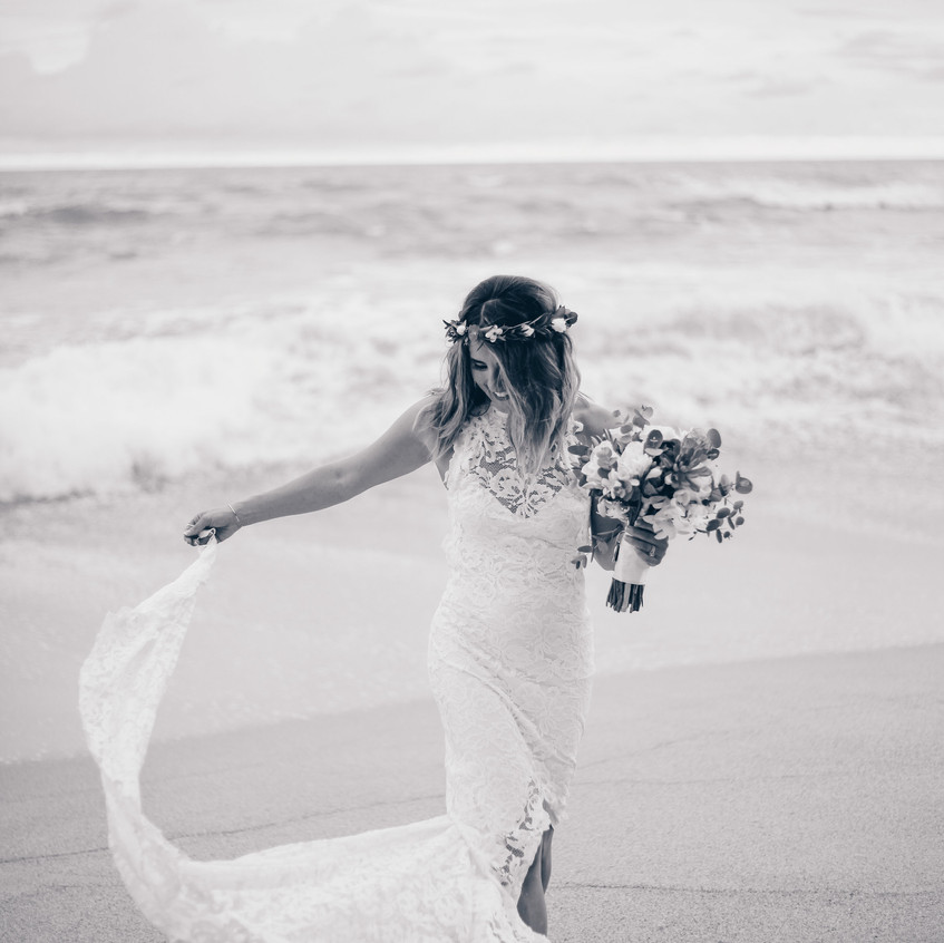 "alt = ""bride in the beach"""