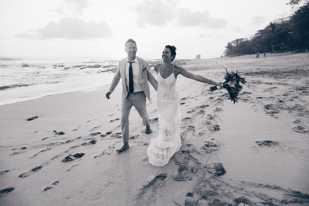 "alt = ""just married on the beach"""