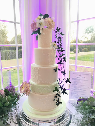 5 tier wedding cake with bespoke bridal