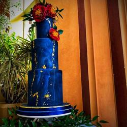 Blue marbled double barrel wedding cake.