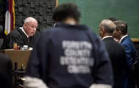 Ferjus Moore with his Lawyers @ Hearing in April 2017