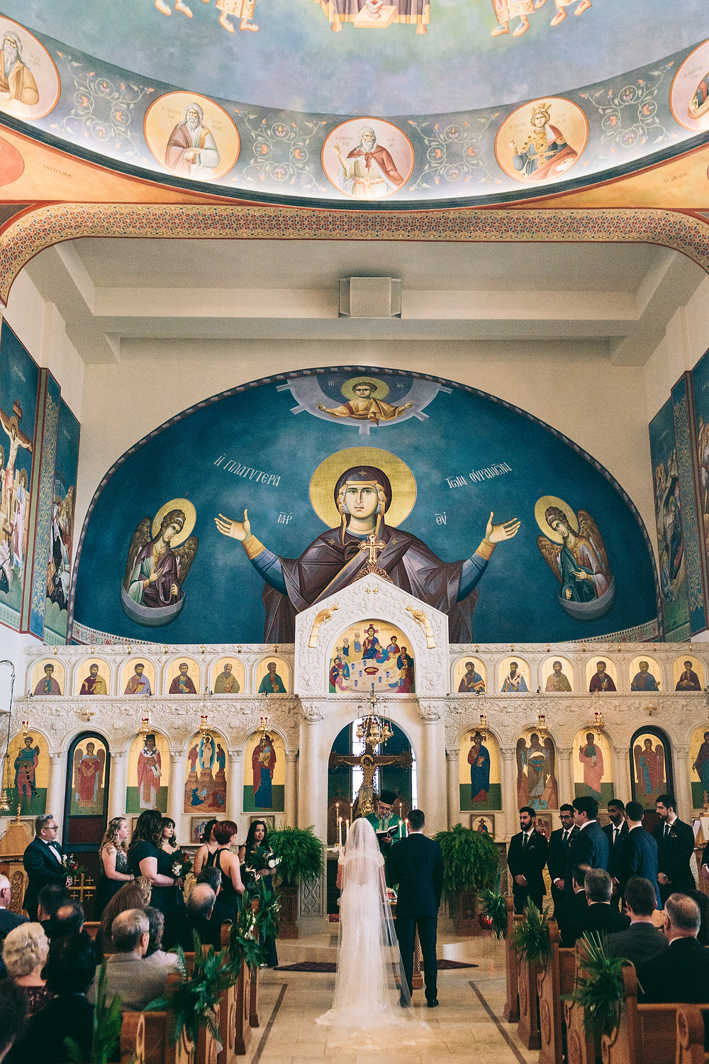 Bride and groom at alter in a Greek Orthodox Wedding In Austin Texas on Unmeasured Events Blog
