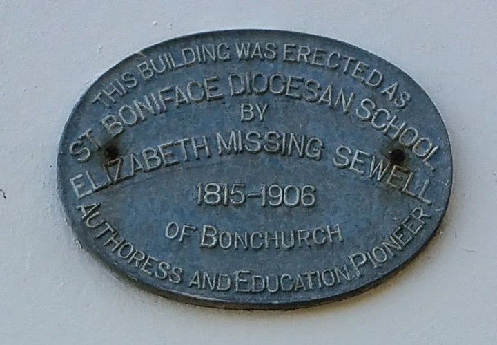The plaque on the side of the building reads - This building was erected as St Boniface Diocesan School by  Elizabeth Missing Sewell 1815-1906 of Bonchurch Authoress and Education Pioneer