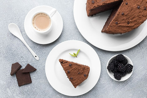 top-view-chocolate-cake-slice-with-coffe