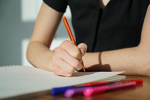 student-writing-on-paper.jpg