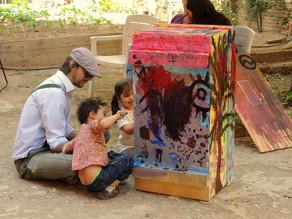 Pintura colaborativa en el proyecto La Plaza Invertida de la artista quebequense Camille Rajotte