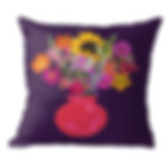 Bright pink vase on deep purple throw pi
