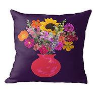 Bright pink vase on deep purple throw pi