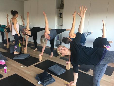 Yoga poses at the wall