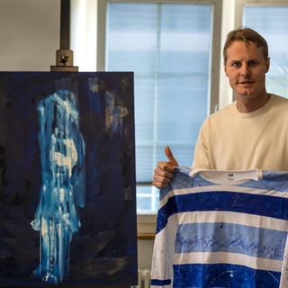 Conor Mccreedy with his commissioned Art Shirt
