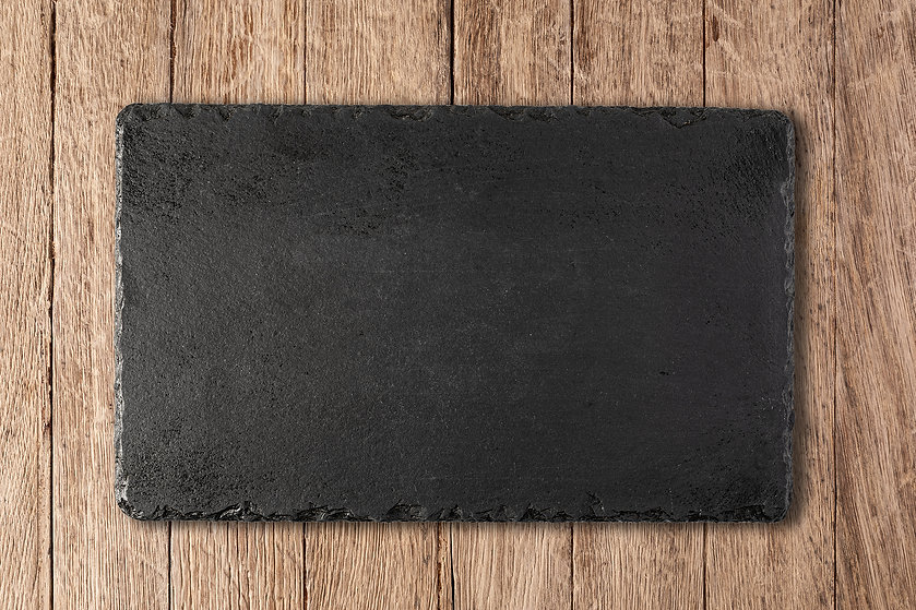 cutting-board-on-a-wooden-table-M9DVNP2-