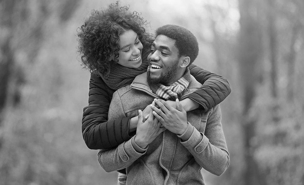 happy-afro-couple-in-love-walking-in-aut