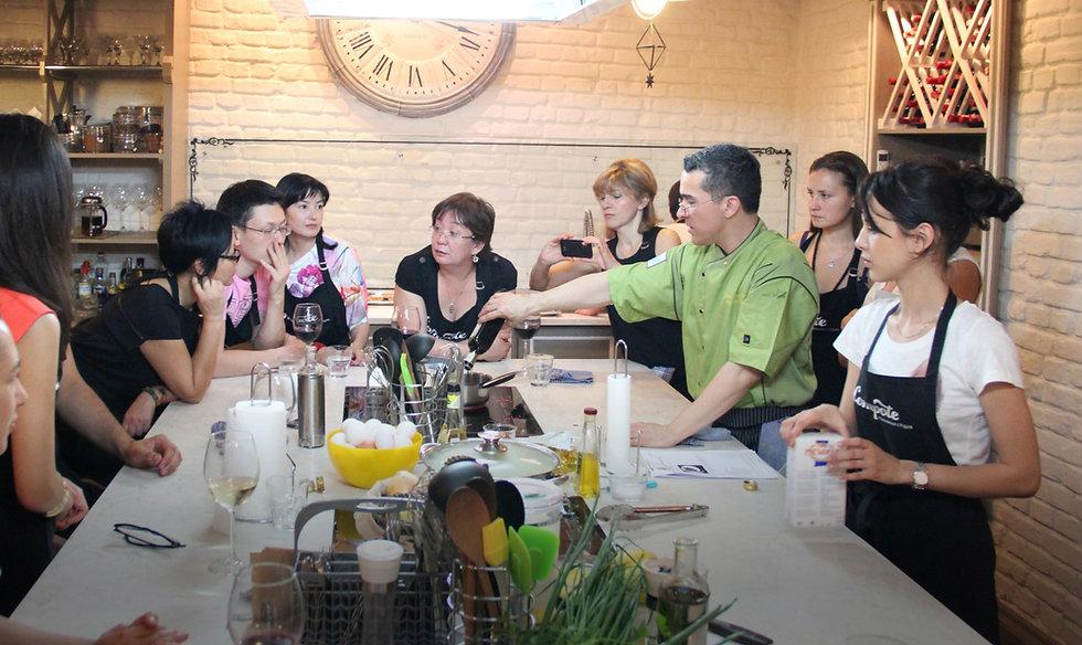 Chef Mark Tafoya teaches a group cooking class