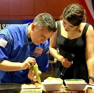 Chef Mark Tafoya doing a cooking demo at a gala event in Nepal