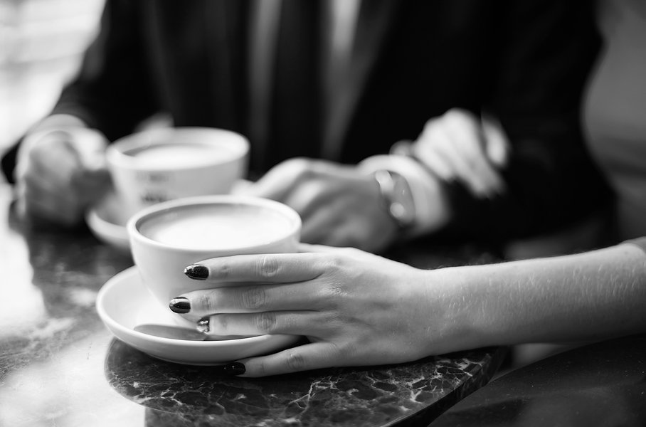 close-up-of-couple-drinking-coffee-XBW66