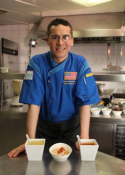 Chef Mark Tafoya with Posole, red and green chile sauces