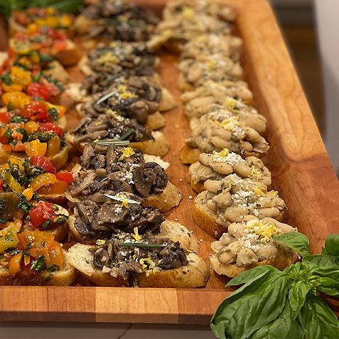 Assortment of crostini: Tomato & basil bruschetta, Wild mushroom & rosemary, and cannelini & sage