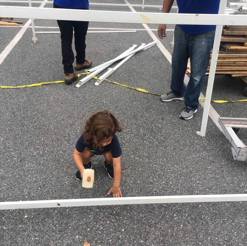 Helping hammer together the Sukkah