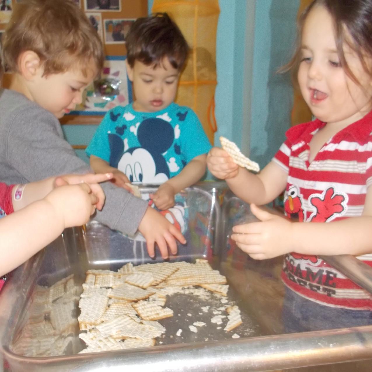 Team Parparim exploring matzah in their sensory table.