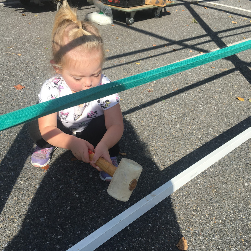 Hammering the Sukkah in place