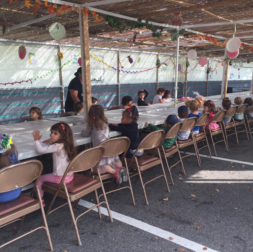 Shabbat snack in the sukkah